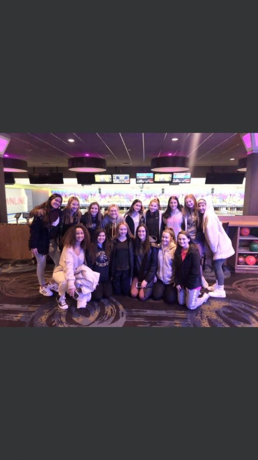 WHS Girls Basketball team at a team building bowling night. The team has been preparing for the season with various bonding activities, according to head coach Joe Lowe.