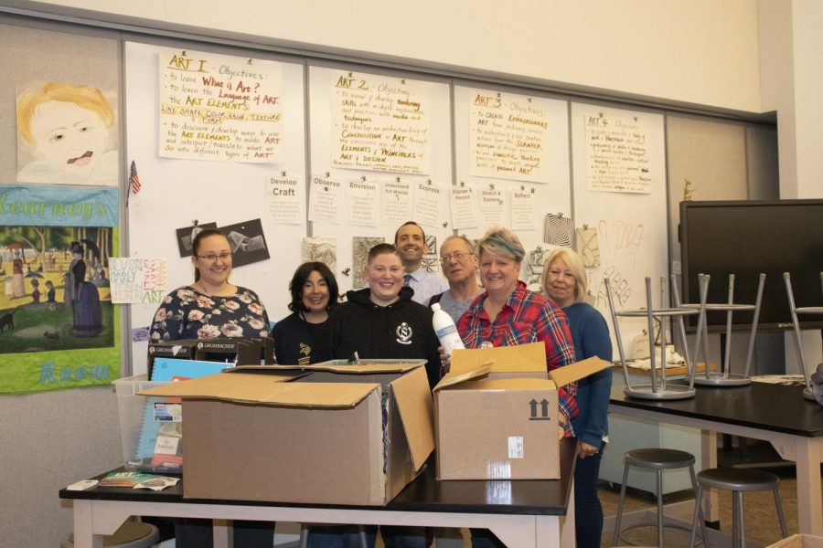 Principal Crombie and the WHS art department accepting an art donation from alumna Lisa Pellechia. Pellechia donated the supplies in honor of former student Katherine Adelstein.