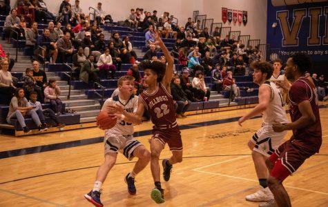 Boys basketball team stays optimistic for remainder of the season