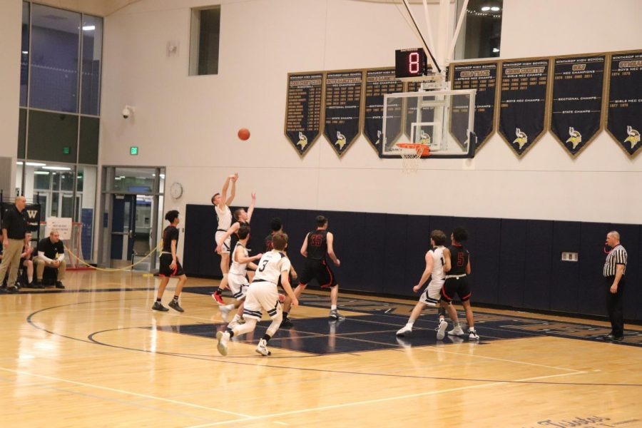 Junior Cam Conway goes for the three pointer.