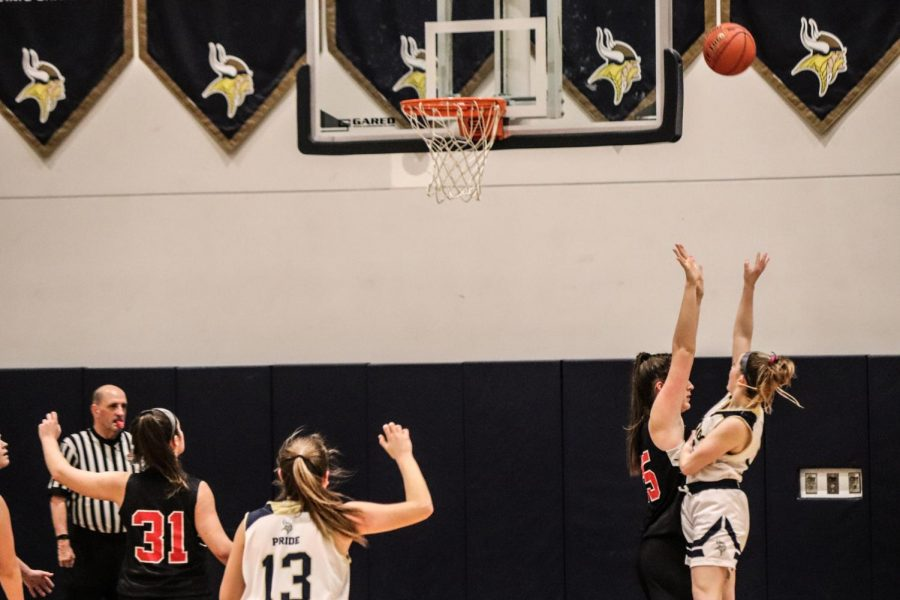 Carolyn Kinsella #11 with the high floater over a Marblehead defender.