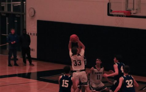 Junior star Camden Conway forces his way into the paint to take a nice jumpsuit from the center of the paint.
