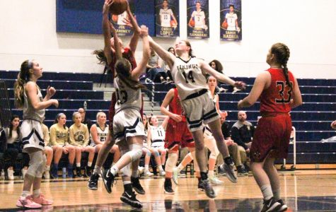 Junior Caroline Earl (right) and Sophomore Julia Marcoccio (middle) reach for and stop the ball as Salem's team attempts to score, Freshman Maddie Stillest (left) waits for the rebound.