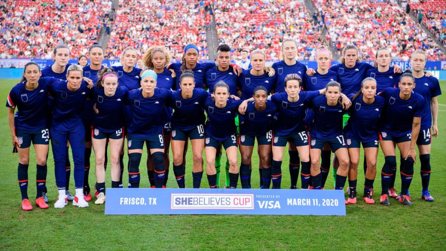 Photo courtesy of Sports Illustrated. To protest for equal pay, the USWNT wear their training uniform inside out so the US Soccer Federation crest is not visible.